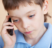 chłopiec telefonu smutny target2458_0_ Fotografia Stock