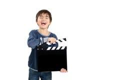Chłopiec trzyma czarnego clapperboard Obrazy Stock
