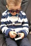 Chłopiec trzyma dolarowych rachunki Obrazy Royalty Free