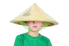 Chłopiec w azjatykcim kapeluszu Zdjęcia Stock