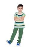 Chłopiec w koszula zielonych pasiastych spojrzeniach naprzód Fotografia Stock
