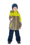 Chłopiec w kurtce trzyma jego kciuk up Obraz Stock