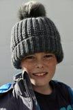 Chłopiec z bobble kapelusz Zdjęcie Stock