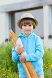 Chłopiec z chlebem Zdjęcia Stock