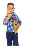 Chłopiec z instrumentem muzycznym zdjęcia stock