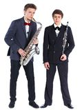 Chłopiec z saksofonem i klarnetem Zdjęcia Stock