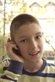 Chłopiec z telefon komórkowy Zdjęcia Royalty Free