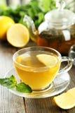 Chá verde no copo e no bule Foto de Stock Royalty Free