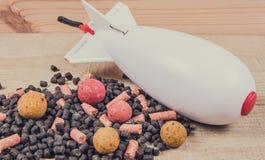 Chaîne avide SPOD d'air de carpe Fusée d'amorce - grande carpe Image libre de droits