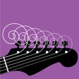 Chaînes de caractères bouclées de guitare Photographie stock libre de droits