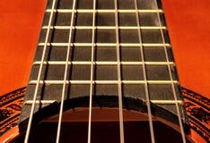 Chaînes de caractères de guitare Photographie stock