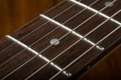 Chaînes de caractères de guitare Photos stock