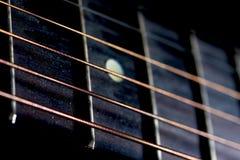 Chaînes de caractères et frettes de guitare Image libre de droits