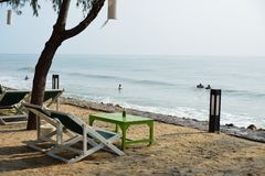Cha-am beach. A chair with table on the beach of Cha-am, Thailand royalty free stock photo