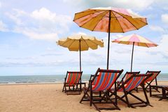 Cha-Am beach in Thailand. Exotic scenic with sunshade parasols and chairs by a beach in Thailand, horizontal image Stock Photo