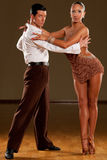 Cha cha cha. Dance couple in brown dress dancing cha cha cha stock photo