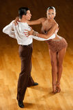 Cha cha cha. Dance couple in brown dress dancing cha cha cha stock photography