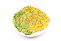 Cha-om omelette. Fried senegalia pennata with egg isolated on white background Royalty Free Stock Photo