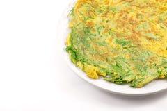 Cha-om omelette. Fried senegalia pennata with egg isolated on white background Stock Photography