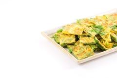 Cha-om omelette. Fried senegalia pennata with egg split isolated on white background Royalty Free Stock Images