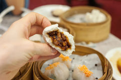 Cha Siu Bao barbequed pork bun at Hong Kong dim sum restaurant. HONG KONG - Cha siu bao is a classic dim sum dish of barbequed pork in a soft steamed bun popular royalty free stock image