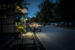 Cha Am Ruam Chit Road. Cha Am, Thailand - August 2017. People leaving the beach to go home at dusk via Ruam Chit road stock image