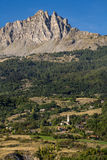 Chabrieres Needles and the Village of L`Eglise, Hautes Alpes, France. Chabrieres Needles Aiguilles de Chabrières and the Village of L`Eglise on a summer Stock Photos