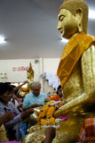 Chachoengsao, Thailand - Aug 7, 2010 : Buddhists pay respect to buddha at Sothorn temple. Buddhist donate money and put gold leaf onto buddha at Sothorn temple Stock Photos