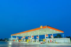 Chachoengsao, Thailand - Jan 28, 2018: Shell gas station blue sk. Y background during sunset. Royal Dutch Shell sold its Australian Shell retail operations to stock images