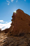 Chaco canyon ruins. The sun is perched behind a ruined wall excavated at chaco canyon new mexico Royalty Free Stock Photos