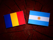 Chad flag with Argentinian flag on a tree stump  Royalty Free Stock Image
