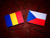 Chad flag with Czech flag on a tree stump  Royalty Free Stock Image