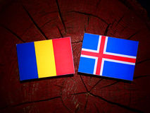 Chad flag with Icelandic flag on a tree stump isolated Royalty Free Stock Image