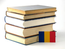 Chad flag with pile of books  on white background Royalty Free Stock Photography