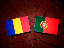 Chad flag with Portuguese flag on a tree stump isolated. Chad flag with Portuguese flag on a tree stump vector illustration