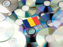 Chad flag on top of CD and DVD pile isolated on white. Chad flag on top of CD and DVD pile isolated Stock Photography