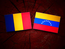 Chad. Flag with Venezuelan flag on a tree stump royalty free stock images