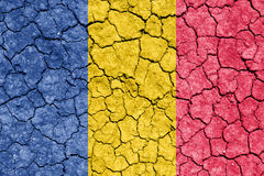 Chad. The image of the flag of Republic of Chad on the cracked dry ground Stock Photography