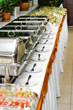 Chafing dish heaters. At the banquet table Royalty Free Stock Photos