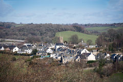 Chagford Village Devon. View of the picturesque town of Chagford on Dartmoor taken looking down from the moor towards the 13th century parish Church royalty free stock images