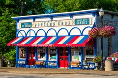 Chagrin Falls landmark shop. CHAGRIN FALLS, OH - JULY 30, 2017: The Popcorn Shop in Chagrin Falls, perched just above the falls themselves, is one of the village royalty free stock photo