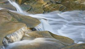 Chagrin river rapids. Waterfall/rapids on chagrin river in the village of Chagrin Falls, Ohio USA royalty free stock photo