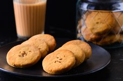 Chai biscuit. Indian Masala milk tea served with jeera ajwain cookies or biscuits.Either home baked or from bakery.Usually eaten at 4pm.Especially popular in stock image