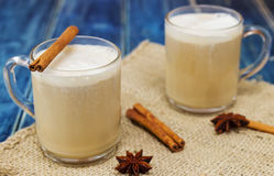 Chai latte spiced tea beverage in glass. Mug with spices Royalty Free Stock Images