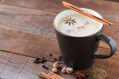Chai. Masala chai with spices. Cinnamon Stick, Thai Cardamom, Ginger, Clove, Star Anise, Black Peppercorns, Fennel Seeds, Black Tea Royalty Free Stock Images