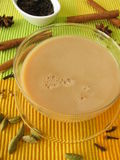 Chai with milk and spices Stock Images
