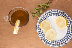 Chai tea with lemon slices and green foliage Royalty Free Stock Photography