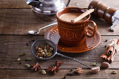 Chai tea masala with spices. Chai tea masala and spices over rustic wooden background Royalty Free Stock Image