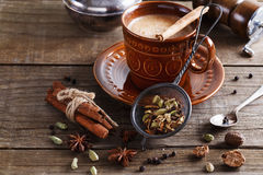 Chai tea masala with spices. Chai tea masala and spices over rustic wooden background Stock Photography