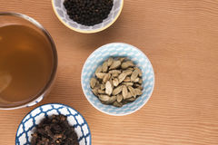 Chai tea surrounded with the ingredients Stock Images